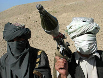 Two members of the Afghani or Pakistani Taliban with weapon