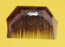 Kanga, the wooden comb, used by Sikhs.