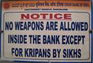 Notice. No weapons are allowed inside the bank except for kripans by sikhs.