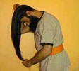 Sikh man combing his long hair.