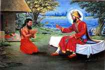 Madho Das being blessed by Guru Gobind Singh Ji after the Birs-his magical forces_were unable to move Guru Ji from the bed which made Madho Das realise the Gurus supreme Godly Powers