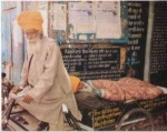 Bhagat Puran Singh carrying destitutes on his personal cycle Rikshaw